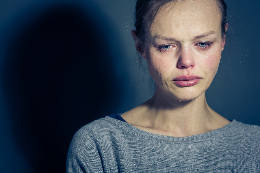 Young woman suffering from severe depression/anxiety/sadness, cr